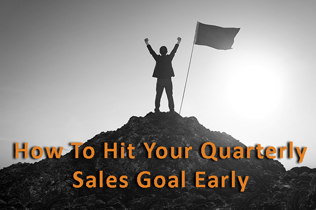 Sales leader standing on a mountain because he just hit his quarterly sales goal