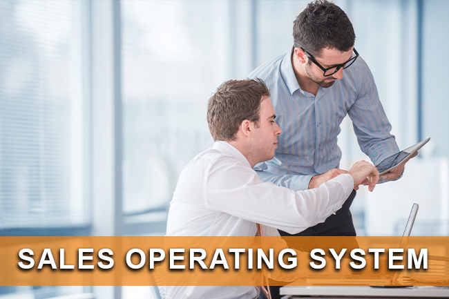 two business people are going over their sales operating system
